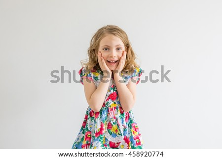 surprised girl with hands up isolated on white - stock photo