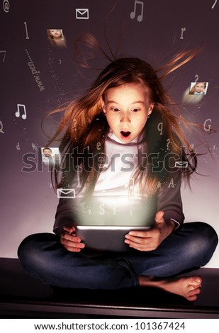 Surprised girl with tablet computer. Computer technology. Flow of information, letters, photos departing from the tablet - stock photo