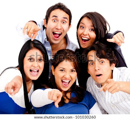Surprised group of people pointing at the camera - isolated - stock photo