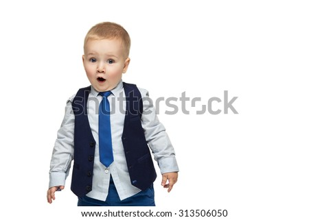 Surprised handsome little boy in business suit with open mouth. True emotion. Isolated over white background. Copy space. - stock photo