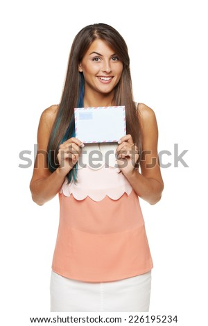 Surprised happy woman showing blank envelope banner, over white background.  - stock photo