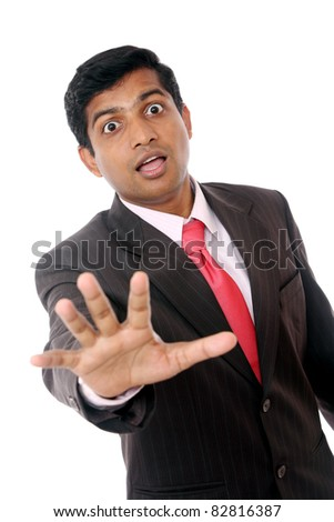 surprised Indian business man isolated on white.