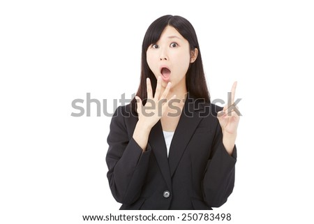 surprised Japanese businesswoman pointing up