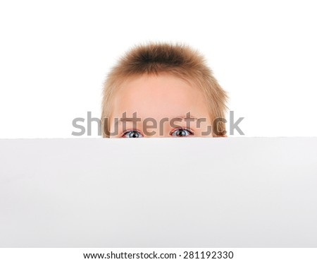 Surprised Kid behind the Blank Paper on the White Background - stock photo