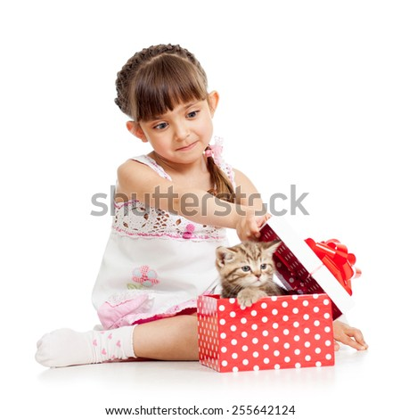 surprised kid girl opening gift box with kitten - stock photo