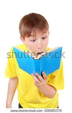 Surprised Kid with a Book Isolated on the White Background - stock photo