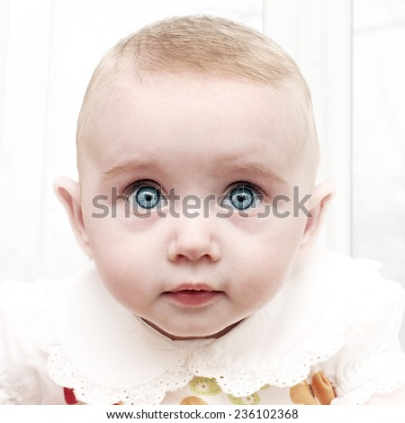 Surprised Little Baby Portrait at the Home - stock photo