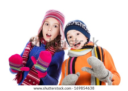 Surprised little boy and girl on the white background - stock photo