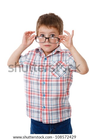 Surprised little boy in glasses, isolated on white