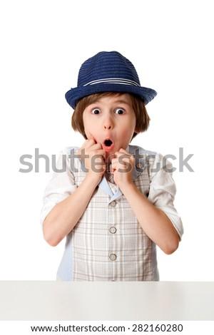 Surprised little boy in hat - stock photo