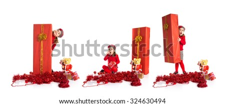 Surprised little girl around christmas elements - stock photo