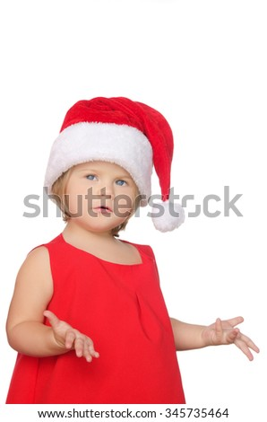 surprised little girl in christmas cap isolated on white - stock photo
