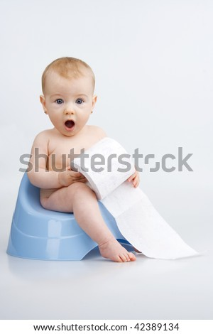 Surprised little girl on potty with lavatory paper,on white background. - stock photo