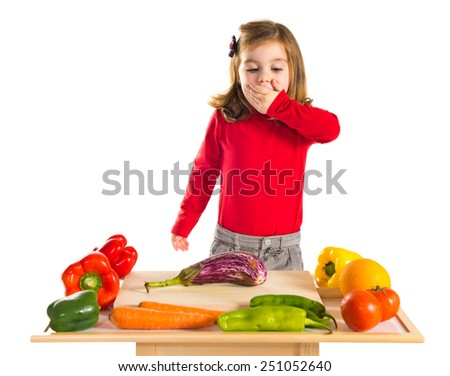 Surprised little girl playing cooking - stock photo