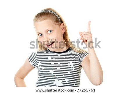 Surprised little girl pointing with finger on white - stock photo