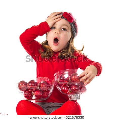 Surprised little girl with christmas elements - stock photo