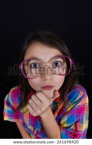 Surprised  little girl with mouth open isolated over yellow background. - stock photo