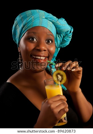 Surprised look on the face of a young african woman having a drink - stock photo