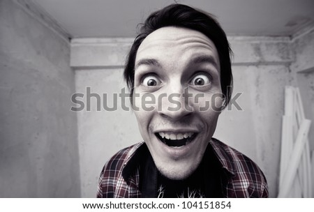 Surprised man at home - stock photo