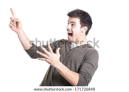 Surprised man looking and pointing up isolated on a white background