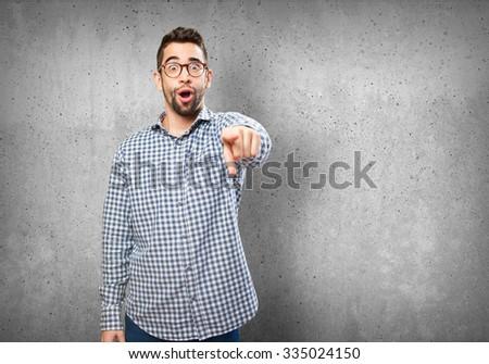 surprised man pointing man - stock photo