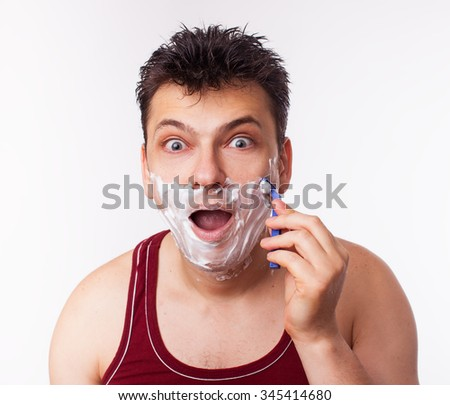 surprised man shaves