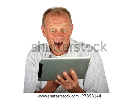Surprised man with his tablet computer - stock photo