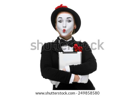 surprised mime with tablet PC in her hands isolated on white  background - stock photo