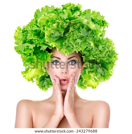 Surprised model girl with Lettuce hair style. Beautiful happy young woman with green vegetables on her head. Healthy food concept, diet, vegetarian food. Dieting concept. Weight loss. Vegan food - stock photo