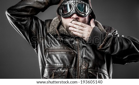 Surprised pilot cap and goggles motorcycle vintage style - stock photo