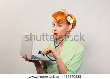 Surprised pinup girl listening computer with stethoscope looking at you retro vintage hairstyle Healthcare diagnosis software repair diagnostics internet threat security safety problem solving concept - stock photo