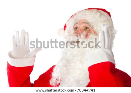 Surprised Santa Claus is looking up isolated over white