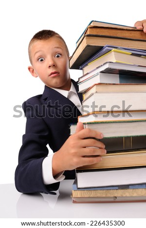 surprised schoolboy with huge stack of books isolated over white background
