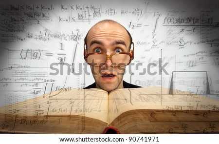 Surprised scientific mathematician with glasses and open book
