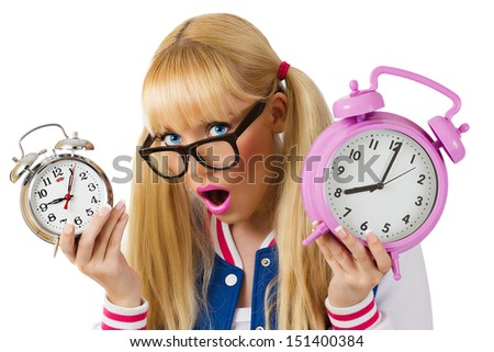 Surprised student girl with clock on white background