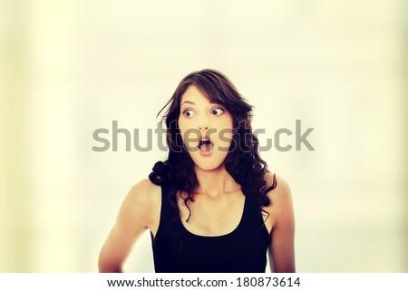Surprised teen woman - stock photo