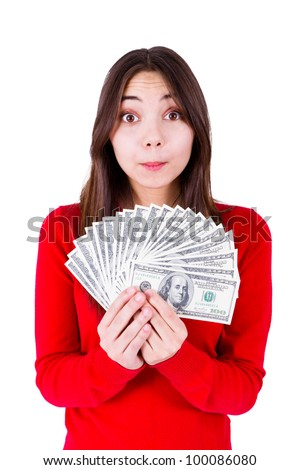 Surprised teenager girl holding her all one hundred dollar banknotes. What am I gonna do all with this money. Isolated on white background. - stock photo