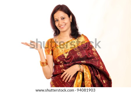 Surprised traditional Indian woman showing open hand palm - stock photo