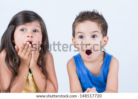 Surprised two children with green eyes - stock photo