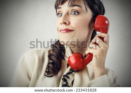 Surprised woman at the phone  - stock photo