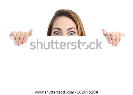 Surprised woman eyes over a blank promotional display isolated on a white background
