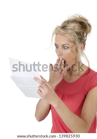 surprised woman gets letter with bad news - stock photo