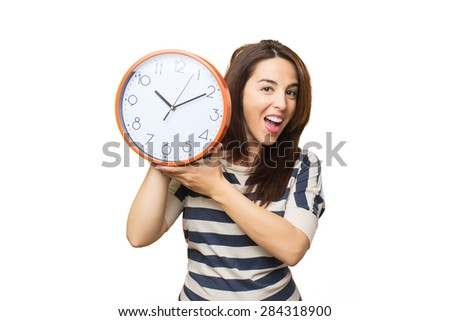 Surprised woman holding a clock. Over white background - stock photo