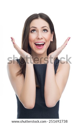 Surprised woman looking up  - stock photo