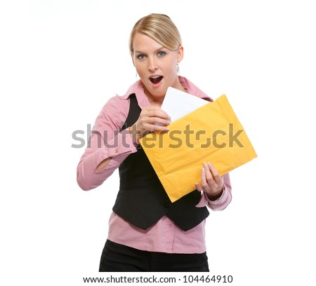 Surprised woman opening letter - stock photo