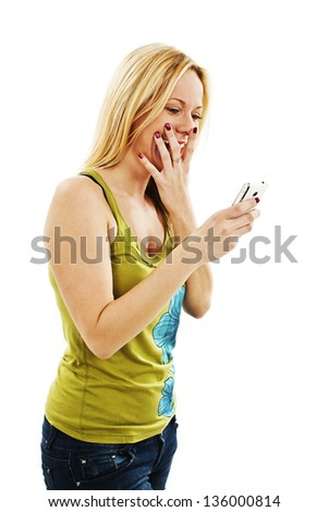 Surprised woman reading shocking sms text message.  Isolated on white background - stock photo