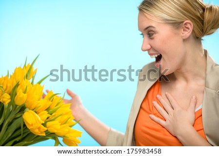 Surprised woman receive bouquet of yellow tulip flowers spring - stock photo