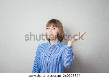 Surprised woman showing open hand palm with copy space for product or text. Gorgeous multiethnic Chinese Asian / white Caucasian female model isolated . - stock photo