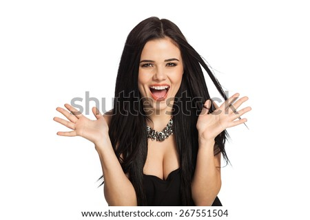 Surprised woman showing open hand palms with copy space for product or text. Gorgeous, smiling white caucasian female model isolated on white background. - stock photo