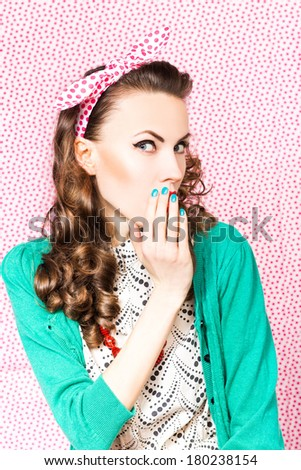 Surprised woman with open mouth. Pinup girl. Beauty woman over red polka dots background. Emotions - stock photo